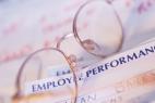 Eyeglasses on top of paper headed Employee Performance
